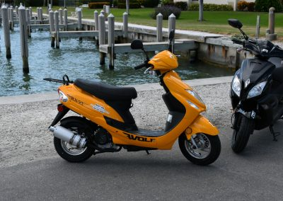 Two scooters parked next to dock