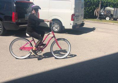 Woman riding a pink bicycle rental