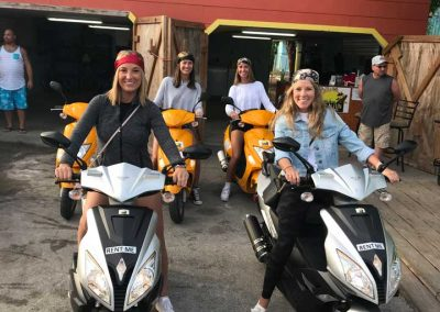 4 girls riding motor scooter rental in Fort Myers Beach