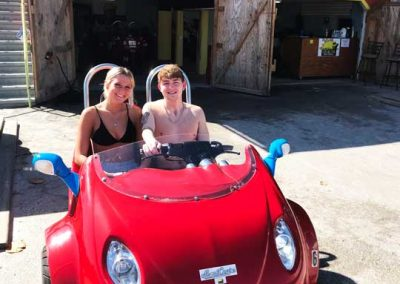 Younger couple renting a red scoot coupe in Fort Myers Beach